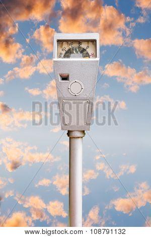 Parking Meter On Orange Cloud Sky