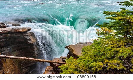 Waters of the Athabasca River Cascading over the Falls