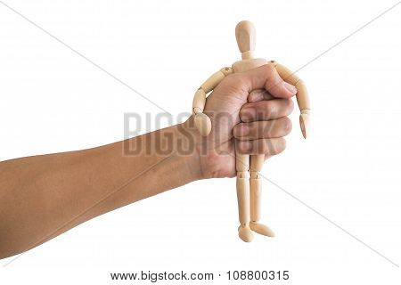 Hand grasp wooden human figure, isolated on white background