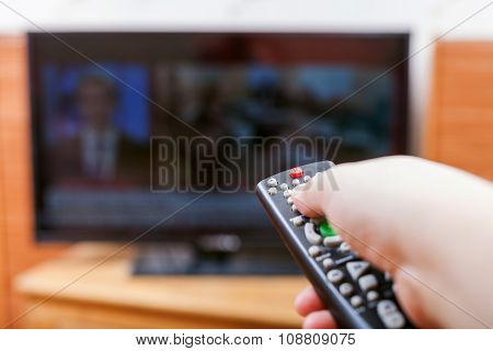 Hand Switches Tv Channels With News