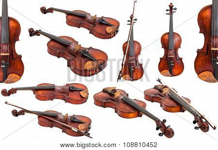 Set Of Old Fiddles Isolated On White