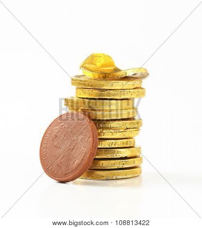 stack of chocolate coins on white background