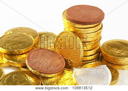 close up of golden chocolate coins stack