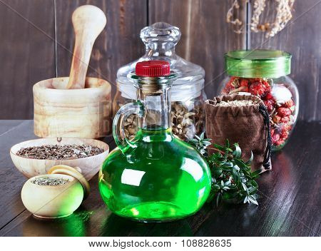 Therapeutic herbal tincture alternative medicine love potions dried herbs on a wooden table. poster