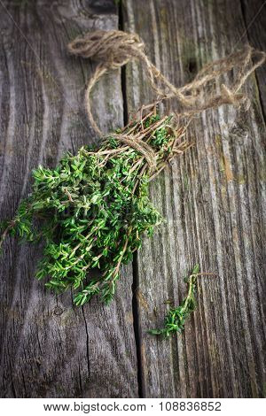 Thyme Bunch On An Old Wooden Background