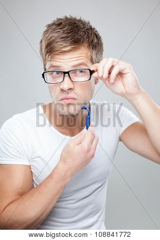 Portrait of a handsome man with glasses shaving poster
