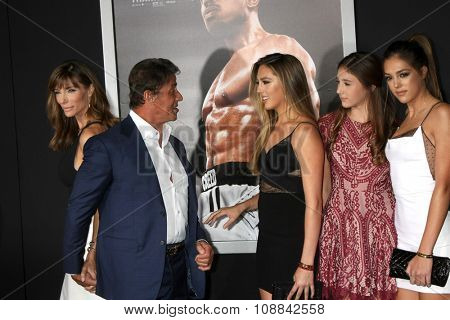LOS ANGELES - NOV 19:  Jennifer Flavin, Sylvester Stallone, daughters at the