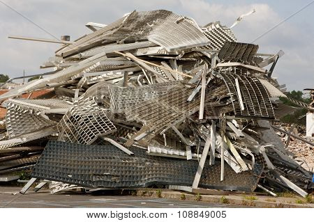 Twisted Metal And Debris Is Piled High At Demolition Site