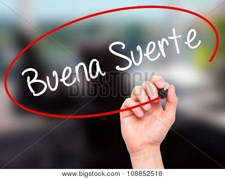 Man Hand writing Buena Suerte( Good Luck in Spanish) with marker on visual screen.
