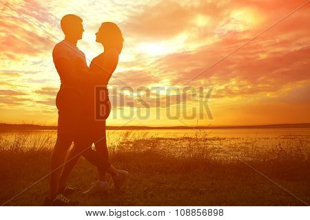 Silhouettes of a young couples