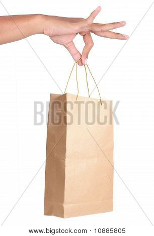 gesture of hand holding paper bags
