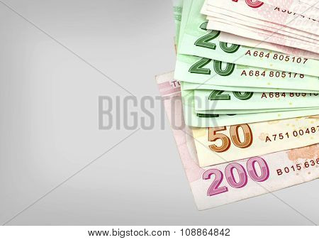 Turkish banknotes. Turkish Lira ( TL ) on grey background.