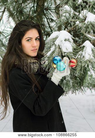 Girl Decorates A Fir Tree