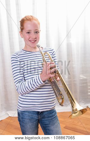Red Haired Teenage Girl Playing The Trumpet