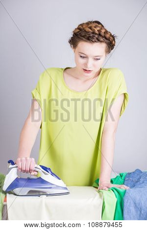 Overworked Housekeeper Ironing Clothes