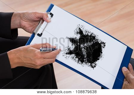Psychologist Showing Rorschach Inkblot To Patient