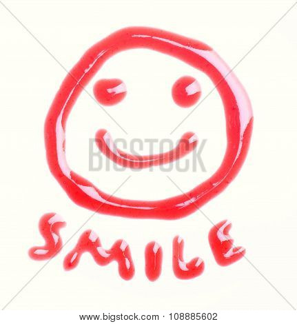 Smiley face made of cherry syrup isolated on the white background. poster