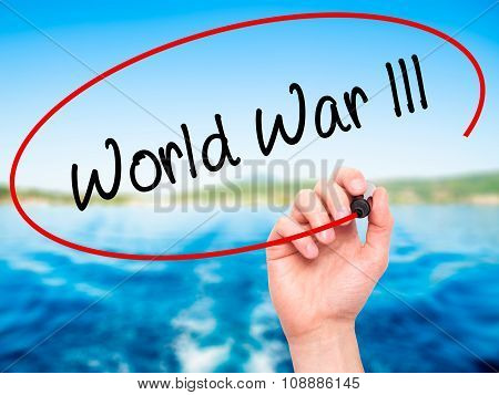 Man Hand writing World War lll with black marker on visual screen.