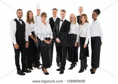 Portrait Of Confident Restaurant Staff Standing In Row