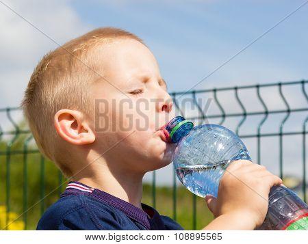 Little Thirsty Boy Child Drink Water From Bottle