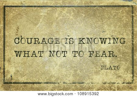 Courage is knowing what not to fear- ancient Greek philosopher Plato quote printed on grunge vintage cardboard poster