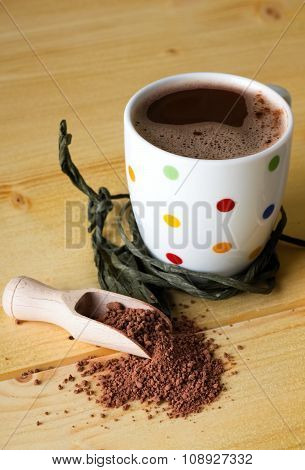 Hot Chocolate And Brown Powder On Light Table