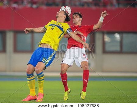 VIENNA, AUSTRIA - SEPTEMBER 9, 2014: Aleksandar Dragovic (#3 Austria) and Zlatan Ibrahimovic (#10 Sweden) fight for the ball in an European Championship qualifying game.