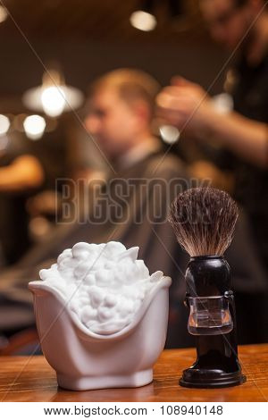 Skillful male hairdresser is working at hair salon