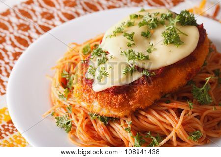 Chicken Parmigiana And Pasta Close-up On A Plate. Horizontal