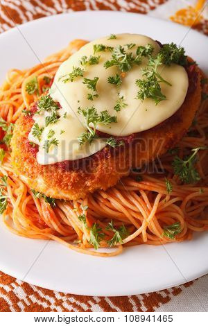 Chicken Parmigiana And Pasta Close-up On A Plate. Vertical
