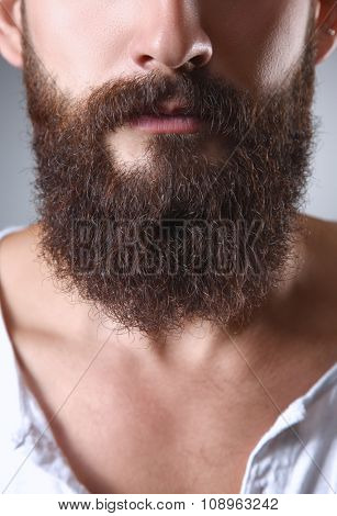 Part of a man's face with  beard