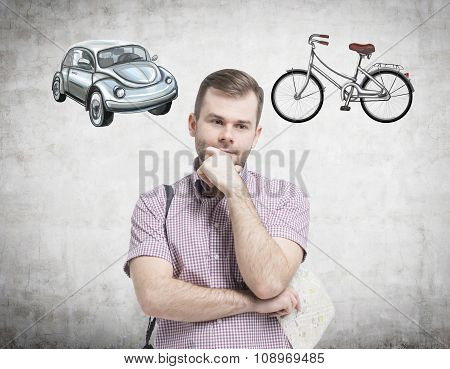 A Handsome Man In Casual Shirt Is Trying To Chose The Most Suitable Way For Travelling Or Commuting.