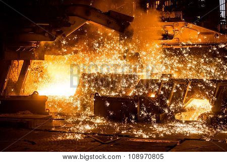 Blast furnace with sparks. Foundry. Heavy industry. poster