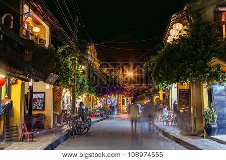 Hoi An, Vietnam - Circa August 2015: People Walking On The Streets Of Old Town Hoi An, Vietnam By  N