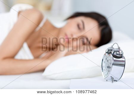 Pleasant girl lying in bed