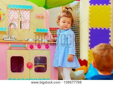 Little Hostess At Toy Kitchen In Kindergarten