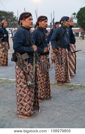 Yogyakarta, Indonesia - Circa September 2015: Ceremonial Sultan Guards In Sarongs With Rifles Stand