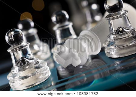 Overthrown King On Blue Chessboard With Crooked Angle And Bokeh