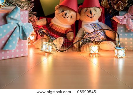 Ornament and teddy bear, Christmas decorate at Merry Christmas night light. Christmas tree and other
