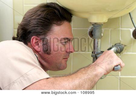 Plumber Tightening Pipe