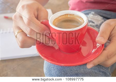 Woman In Torn Jeans Sitting At Coffee Shop