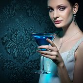 Noble beautiful woman with martini glass on damask wallpaper background poster