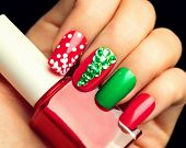Christmas Nail art manicure. Winter Holiday style bright Manicure with gems Christmas tree and snowflakes. Bottle of Nail Polish. Beauty hands. Trendy Stylish Colorful Nails, Nailpolish poster