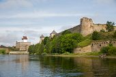 Two ancient fortress - Ivangorod Russia and Narva Estonia on the opposite banks of the river. poster