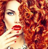 Beauty young woman with curly red hair, perfect make up and manicure. Permed hair. Glamour lady, Beauty Girl. Beautiful Woman Portrait. Blond Wavy Hair, perfect make up poster