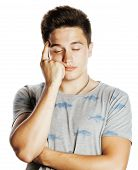 young pretty man with head ache holding hands isolated close up thinking poster