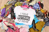 Close up on a untidy cluttered wardrobe with colorful clothes and accessories many clothes and nothing to wear. poster