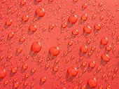 rain droplets formed on red metallic surface poster