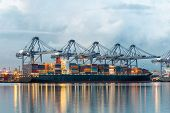 Container Cargo freight ship with working crane bridge in shipyard for Logistic Import Export background poster