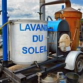 "Retro apparatus for distillation of lavender oil on a rural market in Provence France. Title on the tank ""Lavander du Soleil"" means ""Lavender Sun"" poster"